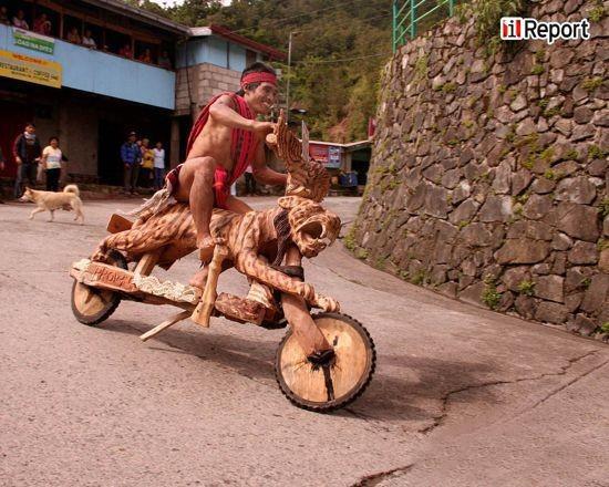 重力��:菲律�e的木制小摩托比�