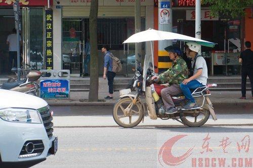 你的摩托车上加装遮阳伞了吗?实验证明隐患多